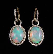 Lot 461: PAIR OF OPAL AND DIAMOND DANGLE EARRINGS, each 14k
