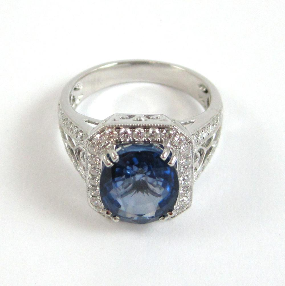 Lot 481: SAPPHIRE, DIAMOND AND FOURTEEN KARAT GOLD RING. Th