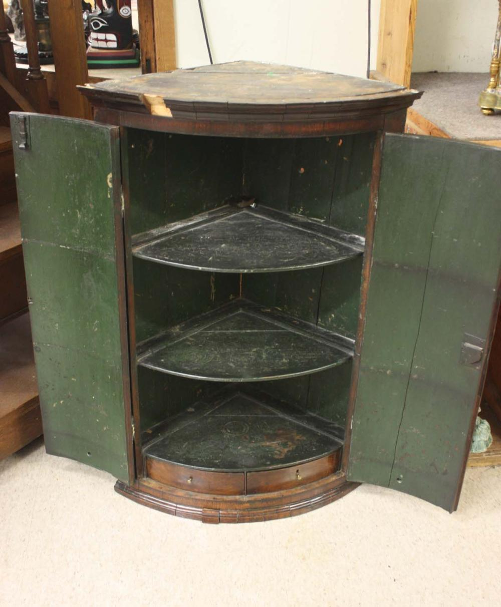 Lot 500: GEORGE III PERIOD BOW-FRONTED HANGING CORNER CABIN