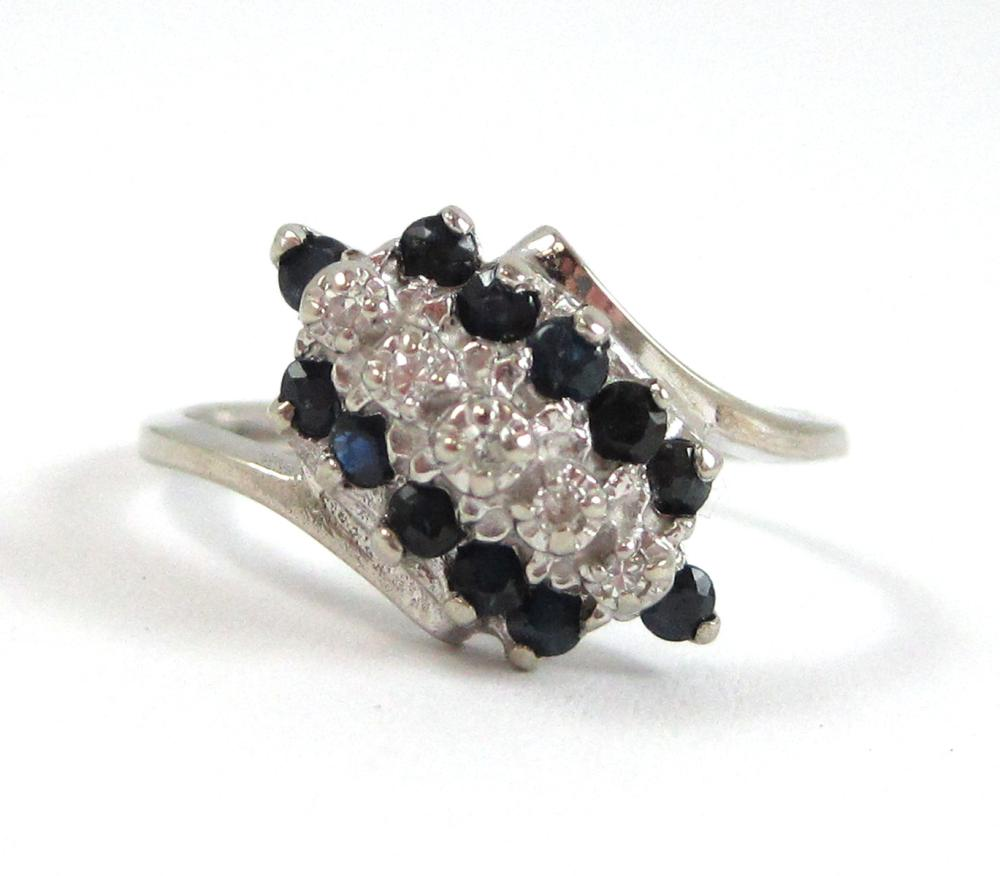 Lot 488: TWO GOLD RINGS, including a 10k white gold ring se