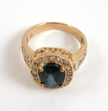 Lot 493: SAPPHIRE, DIAMOND AND FOURTEEN KARAT GOLD RING, wi