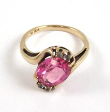 Lot 505: PINK SAPPHIRE AND YELLOW GOLD RING. The 10k yello