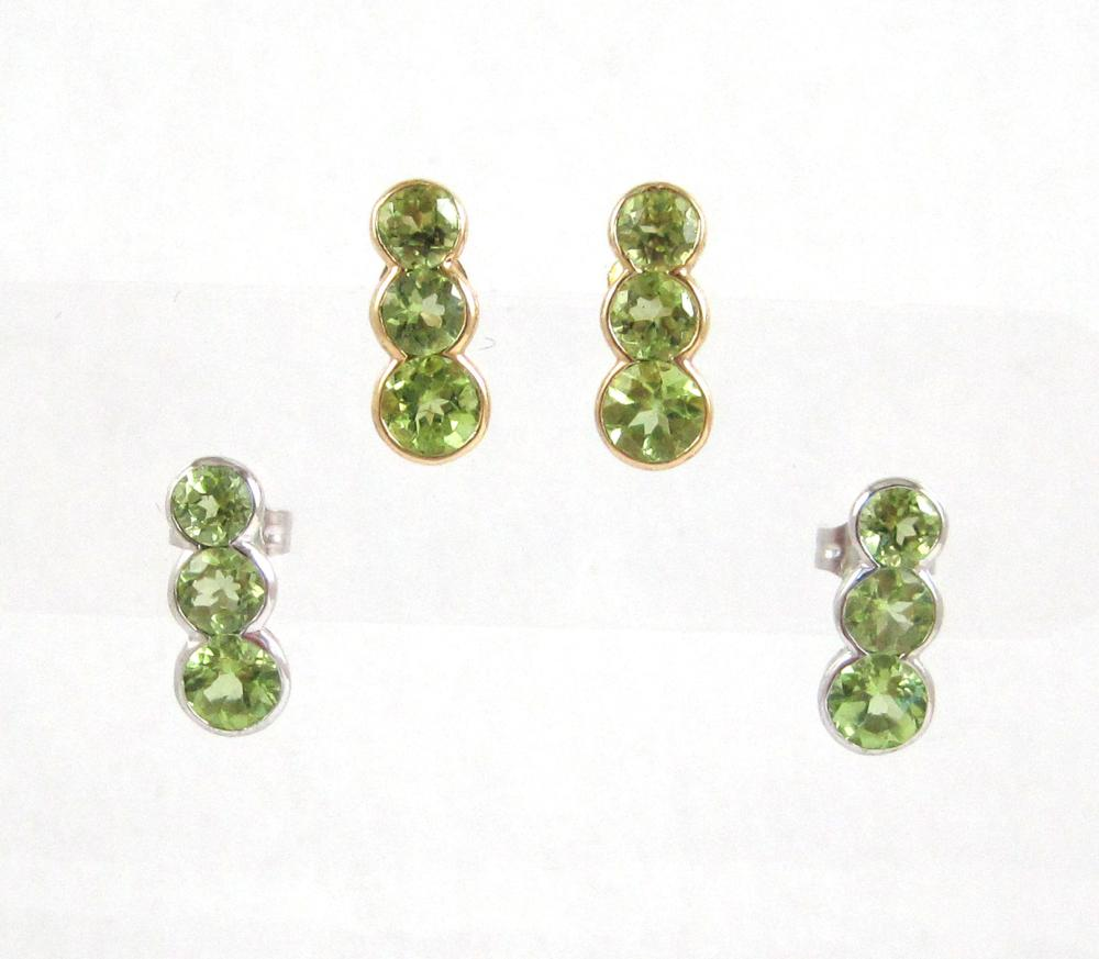 Lot 541: TWO PAIRS OF PERIDOT STUD EARRINGS, including a pa
