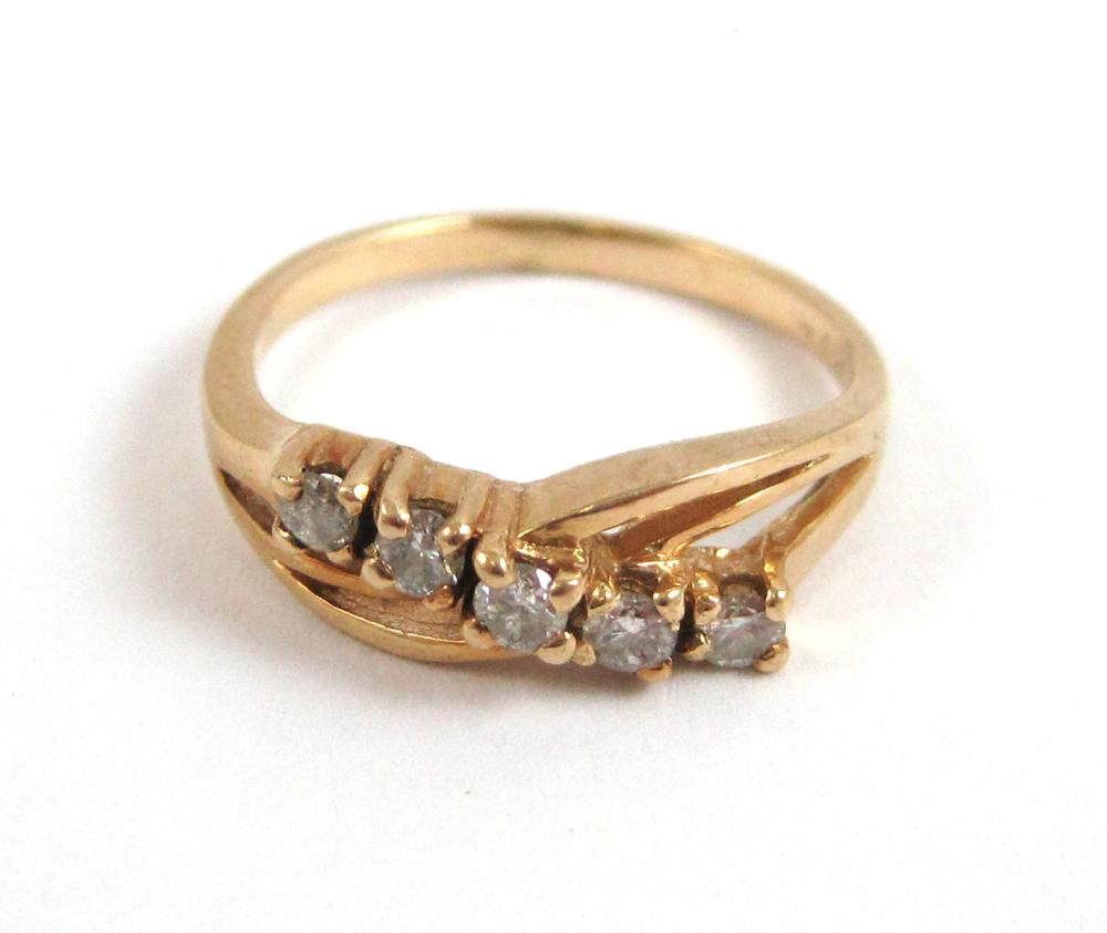 Lot 572: COLLECTION OF SIX GOLD RINGS, including an 18k whi