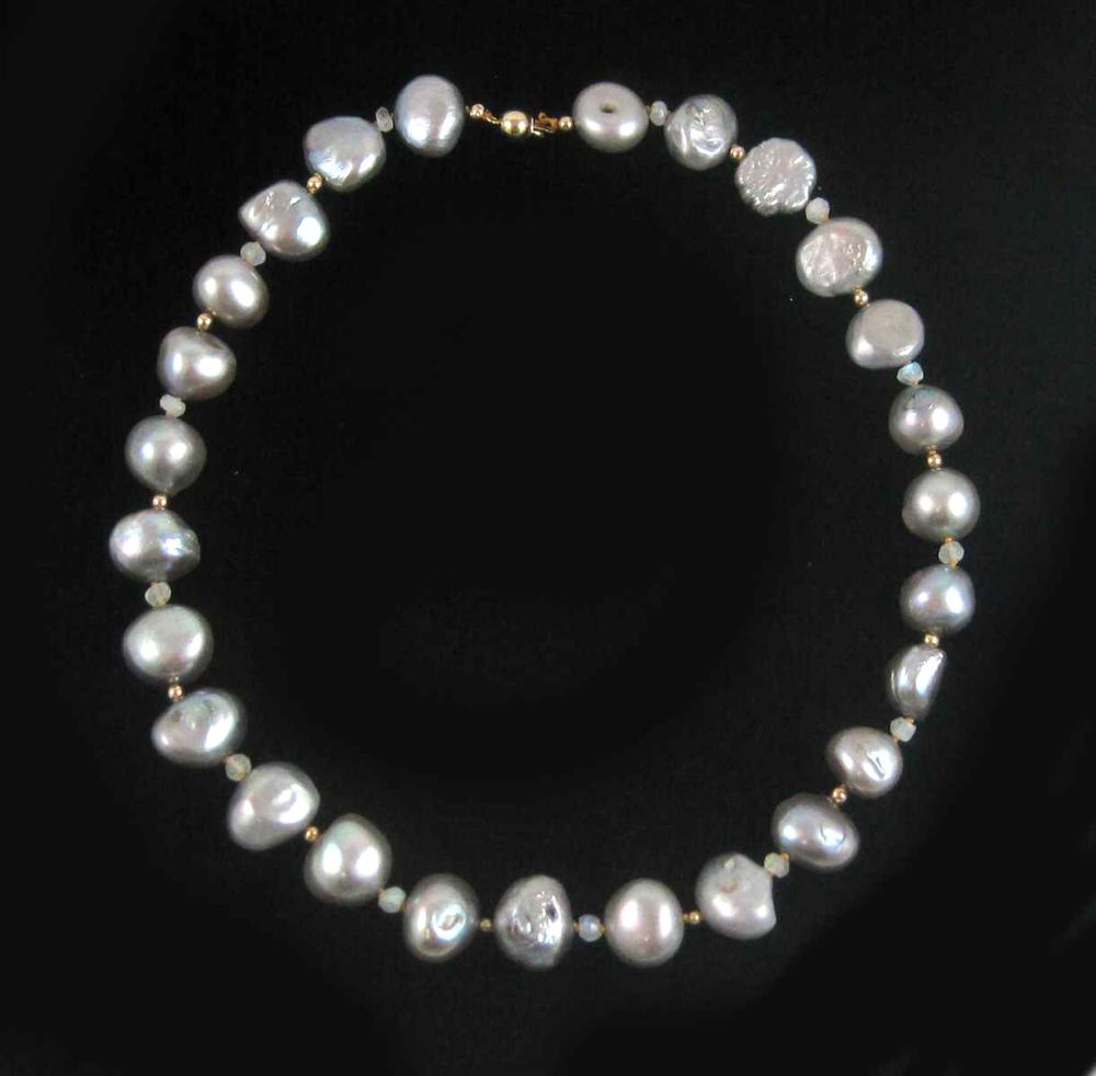 Lot 421: PEARL, MOONSTONE AND FOURTEEN KARAT GOLD NECKLACE.