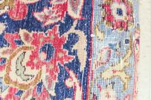 Lot 554: SEMI-ANTIQUE PERSIAN CARPET, floral and central fl