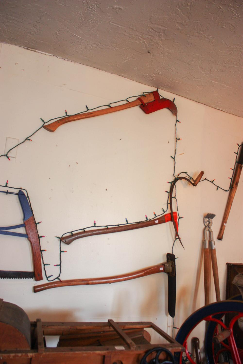 A WALL OF VINTAGE AND ANTIQUE HAND TOOLS