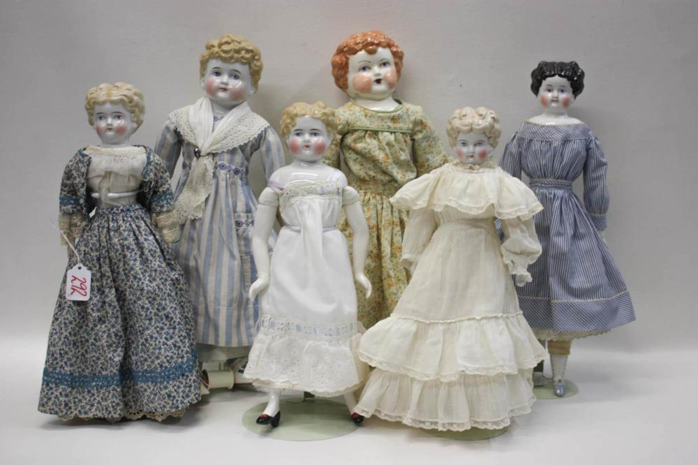 Lot 287: SIX CHINA HEAD DOLLS: 4 with blonde molded hair,