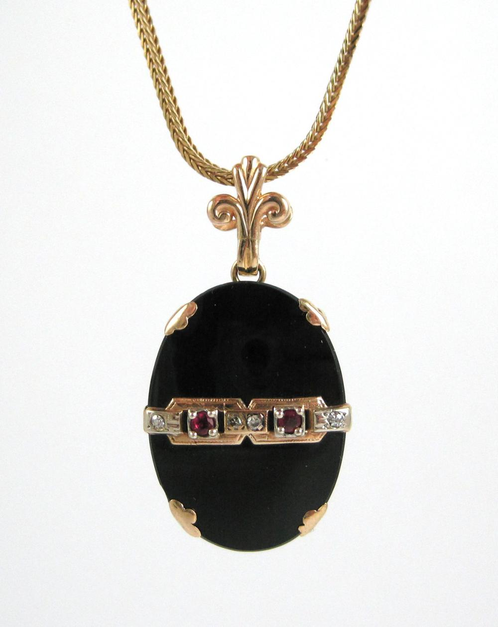 Lot 23: BLACK ONYX, RUBY AND DIAMOND PENDANT NECKLACE, wit