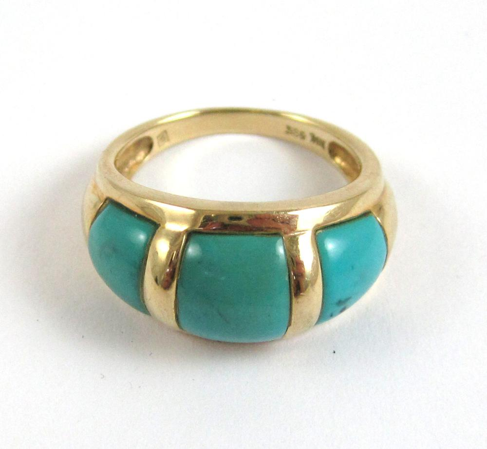 Lot 30: TURQUOISE AND FOURTEEN KARAT GOLD RING, with three