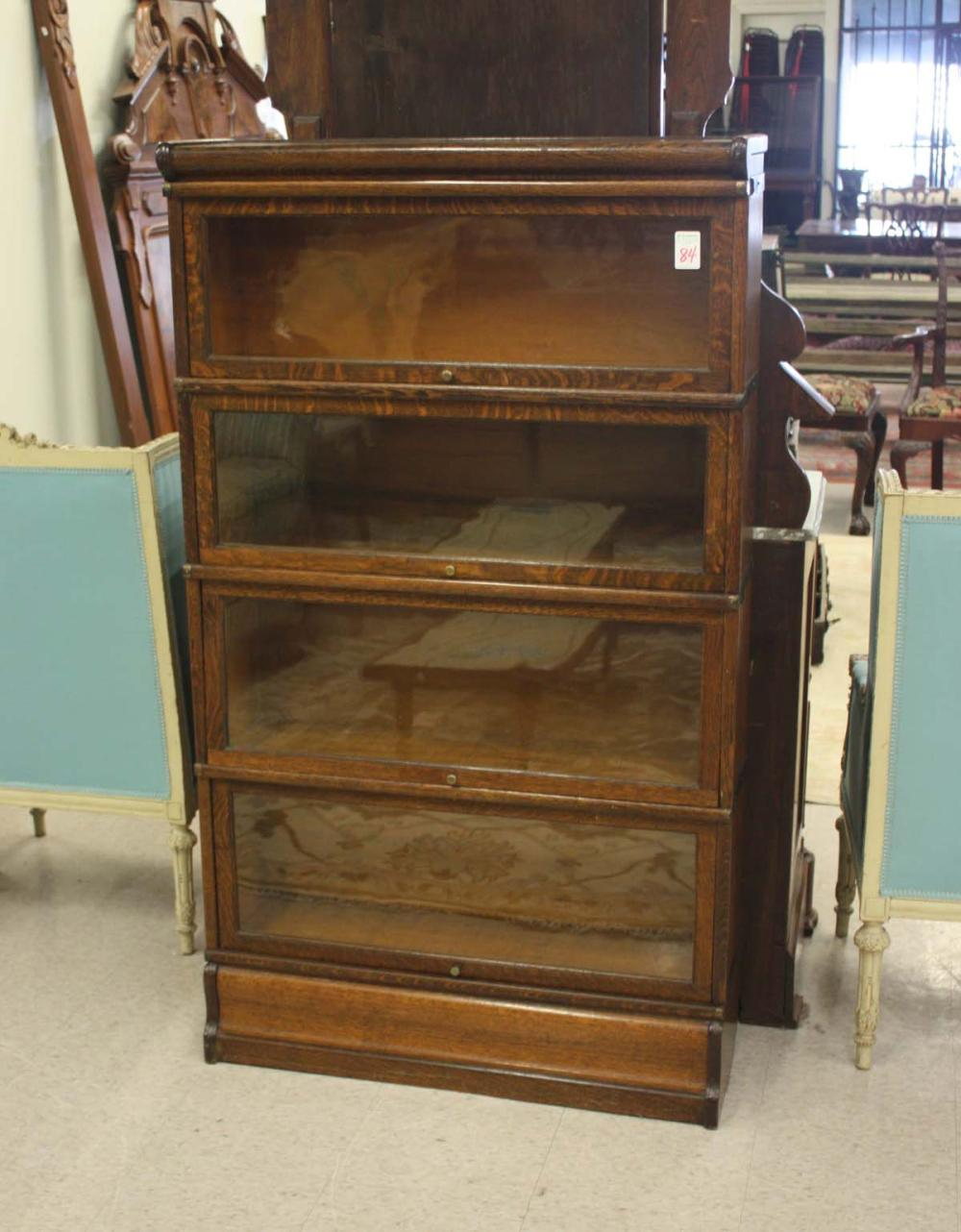 Lot 84: FOUR-SECTION STACKING OAK BOOKCASE, American, c. 1