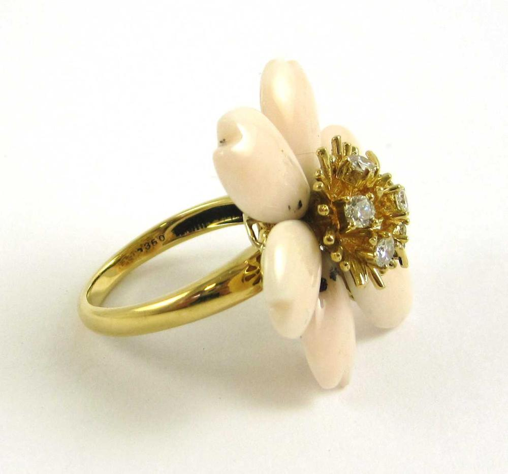 Lot 102: CORAL, DIAMOND AND EIGHTEEN KARAT GOLD RING. The