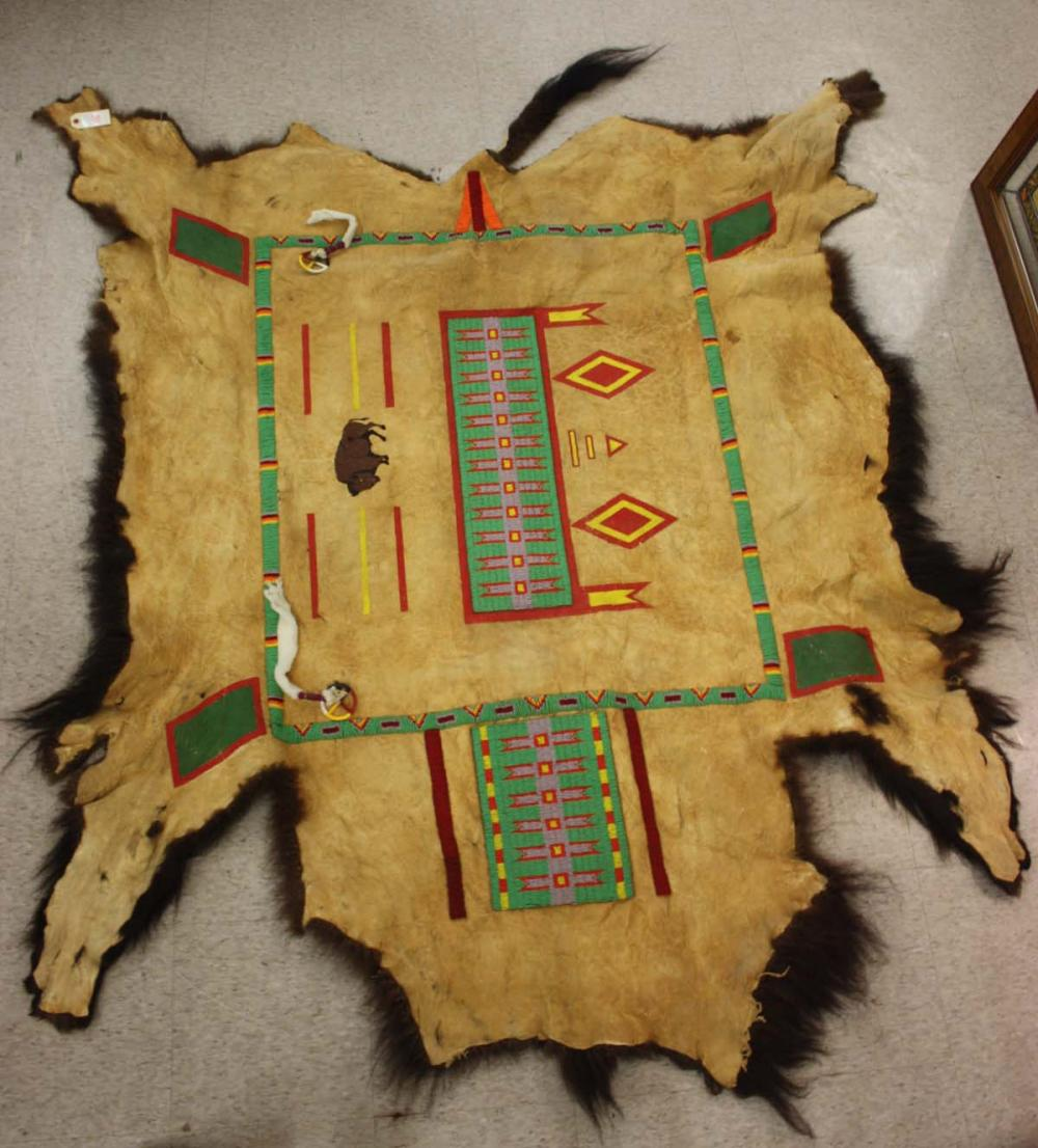 Lot 106: NATIVE AMERICAN BEADED AND PAINT-DECORATED BUFFALO
