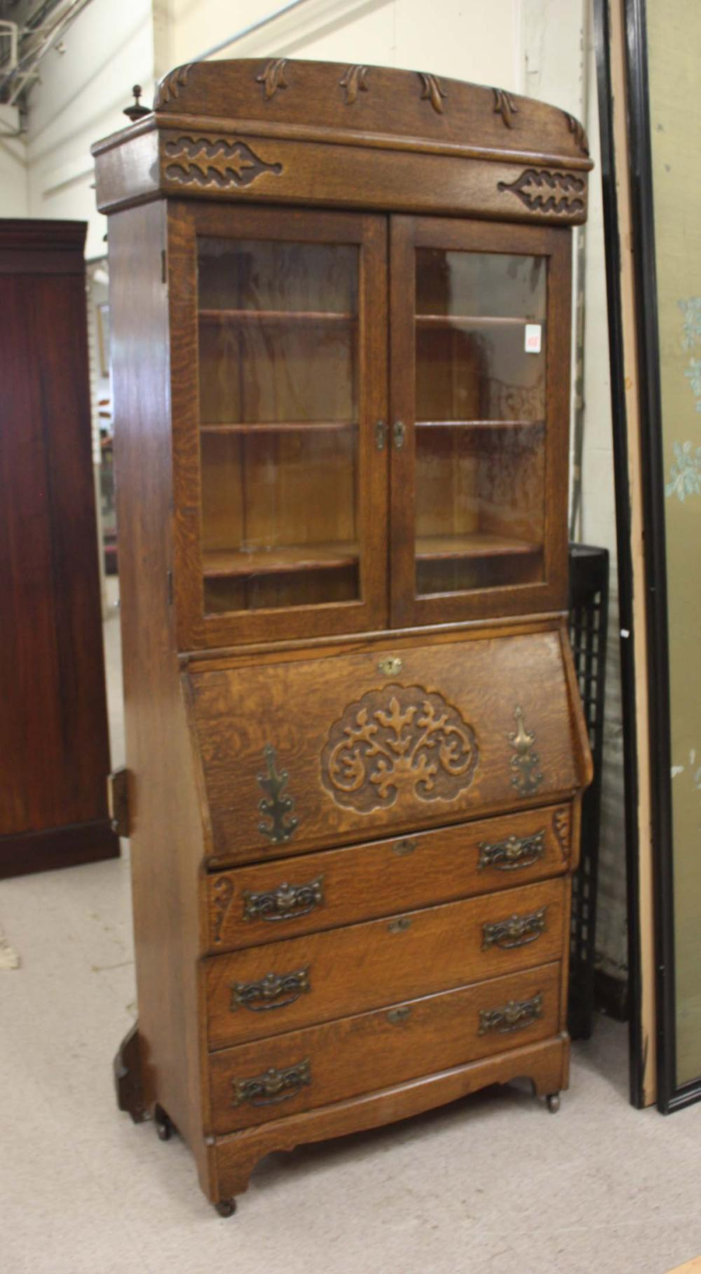 Lot 108: LATE VICTORIAN CARVED OAK SECRETARY BOOKCASE, Rock
