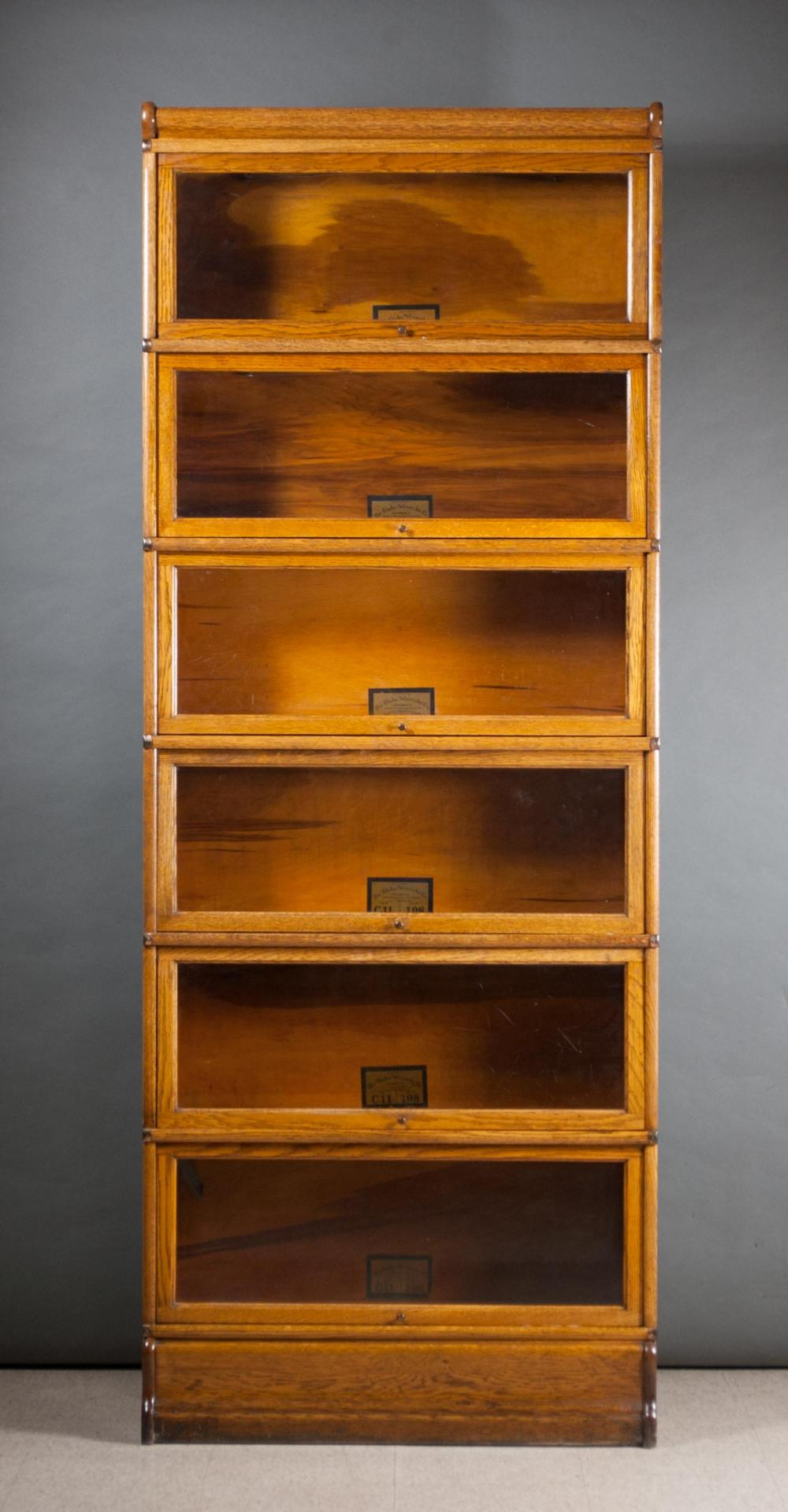 Lot 113: SIX-SECTION STACKING OAK LAWYER BOOKCASE, Globe-We
