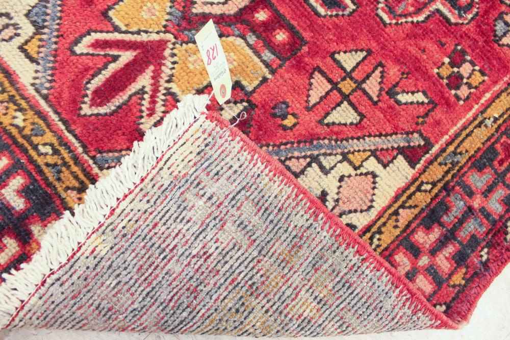 Lot 128: TWO SEMI-ANTIQUE PERSIAN RUNNERS, both hand knotte