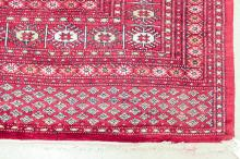 Lot 136: HAND KNOTTED RED BOKHARA CARPET, Indo-Turkman, rep
