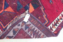 Lot 150: HAND KNOTTED PERSIAN TRIBAL HALL RUG, featuring a