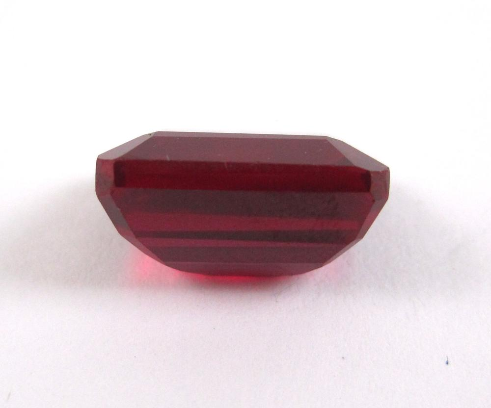 Lot 152: UNSET RUBY WITH CERTIFICATE OF AUTHENTICITY CARD.