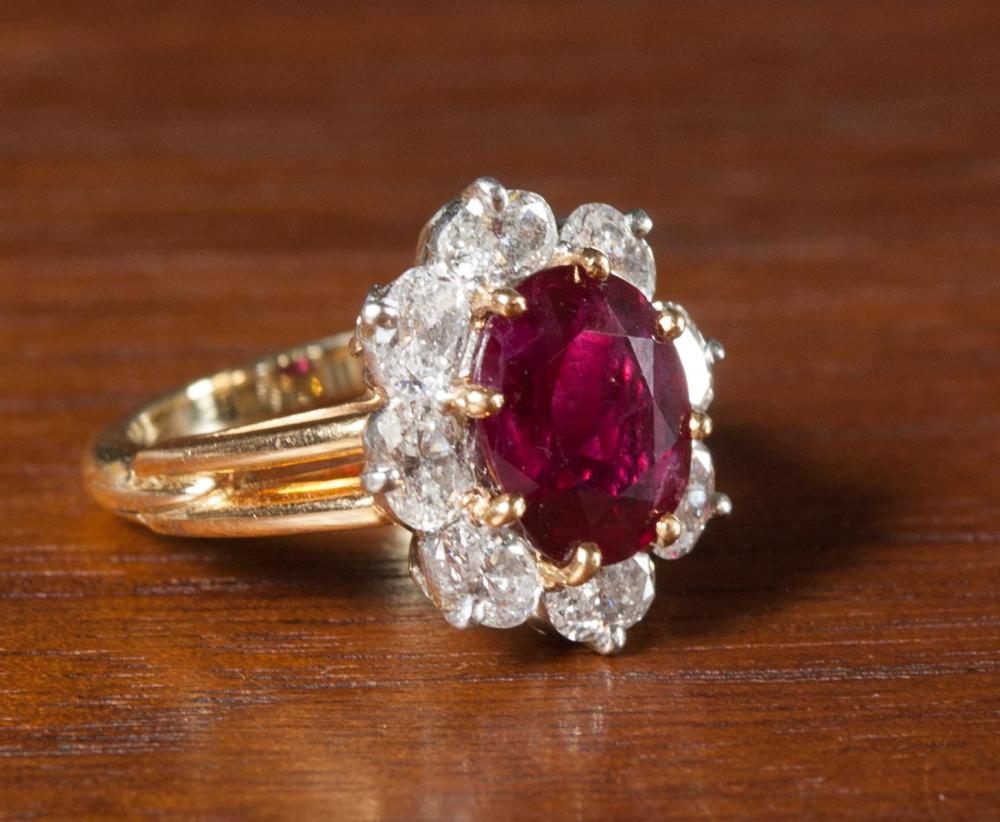 Lot 169: DIAMOND, RUBY AND FOURTEEN KARAT GOLD RING. The 1