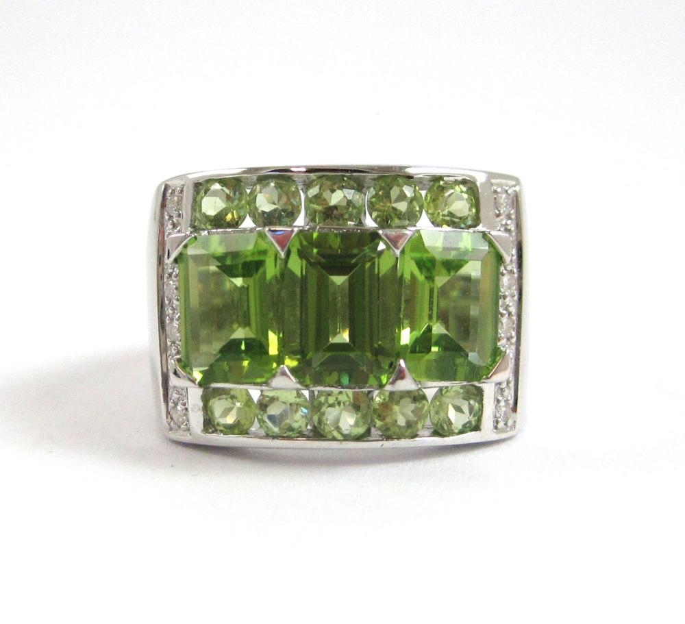Lot 176: PERIDOT, DIAMOND AND FOURTEEN KARAT GOLD RING. Th