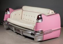 Lot 180: VINTAGE PINK CADILLAC CONVERSION LOVESEAT, the rea