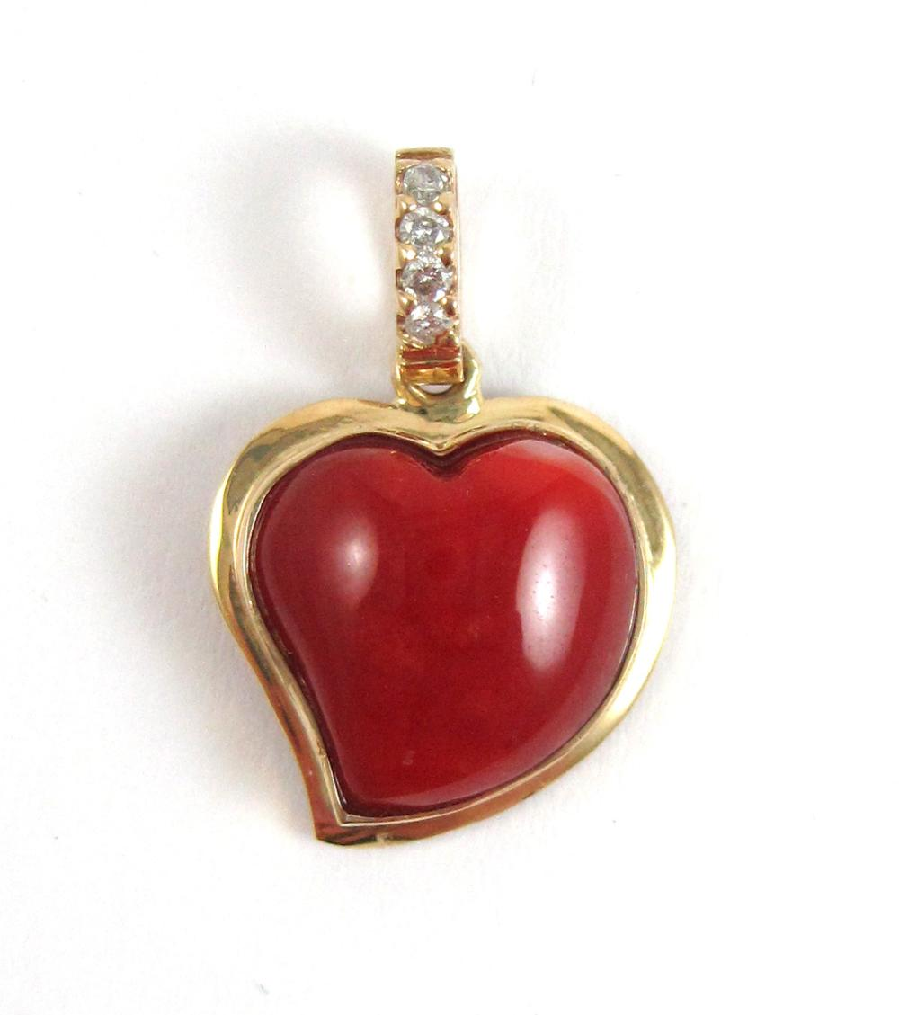 Lot 211A: CORAL, DIAMOND AND FOURTEEN KARAT GOLD PENDANT, wi