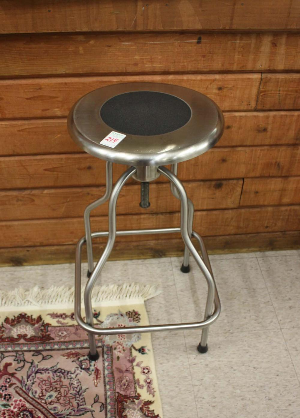 Lot 214: A SET OF THREE STAINLESS STEEL COUNTER STOOLS, UMF