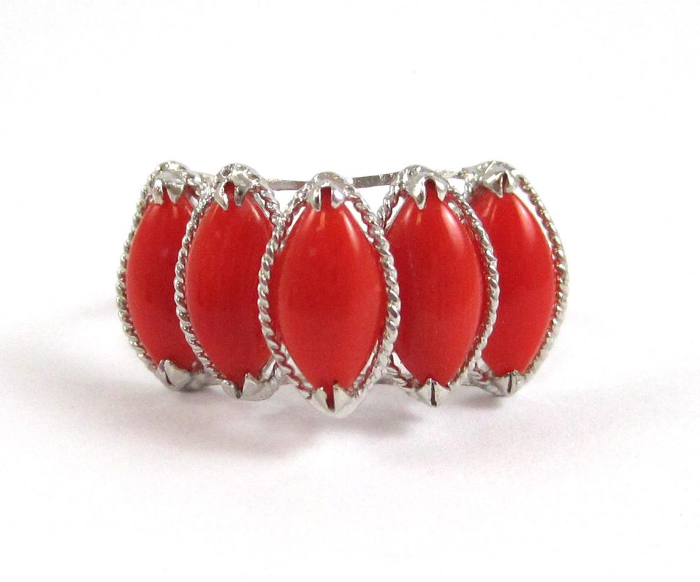 Lot 210: CORAL AND FOURTEEN KARAT WHITE GOLD RING, set with