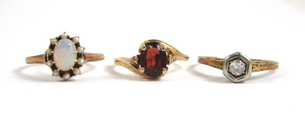 Lot 218: COLLECTION OF THREE YELLOW GOLD RINGS, including a