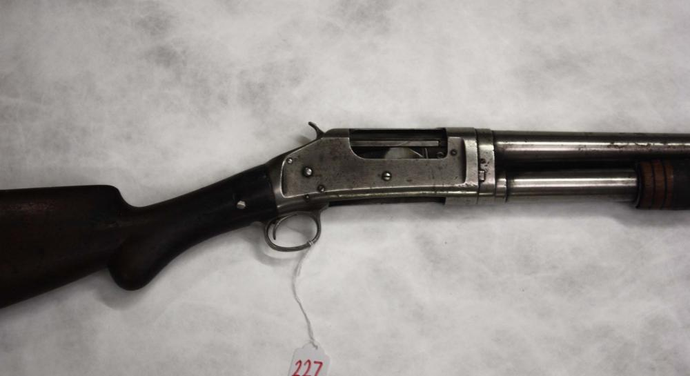 Lot 227: WINCHESTER MODEL 1897 SLIDE ACTION SHOTGUN, 12 gau