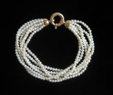 Lot 234: PEARL AND FOURTEEN KARAT GOLD NECKLACE AND BRACELE
