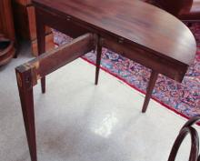 Lot 144: LATE FEDERAL MAHOGANY DEMILUNE GAME TABLE, America