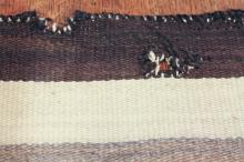 Lot 19: VINTAGE HAND WOVEN NAVAJO RUG, in the manner of J.