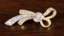 DIAMOND AND FOURTEEN KARAT GOLD BROOCH.  The yello
