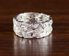 DIAMOND AND PLATINUM RING.  The wide, pierced plat