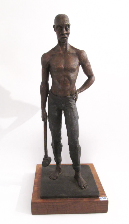 BRONZE SCULPTURE, African man with sledge hammer.