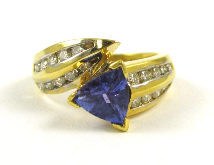 LEVIAN TANZANITE AND EIGHTEEN KARAT GOLD RING, wit