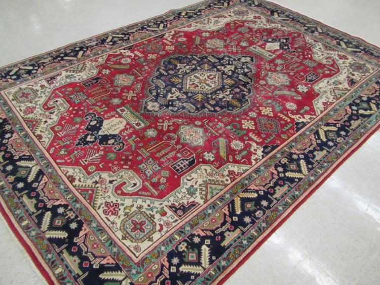SEMI-ANTIQUE PERSIAN CARPET, hand knotted in a cen