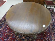 AN OVAL OAK DINING TABLE, French, 19th century, th