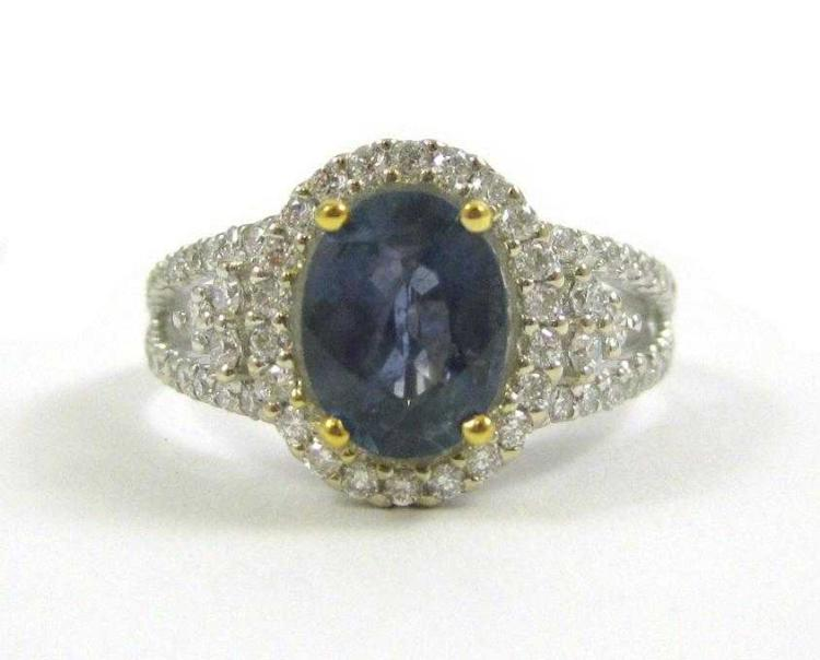 SAPPHIRE, DIAMOND AND FOURTEEN KARAT GOLD RING.  T