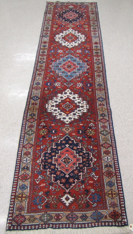 HAND KNOTTED PERSIAN RUNNER, having five geometric