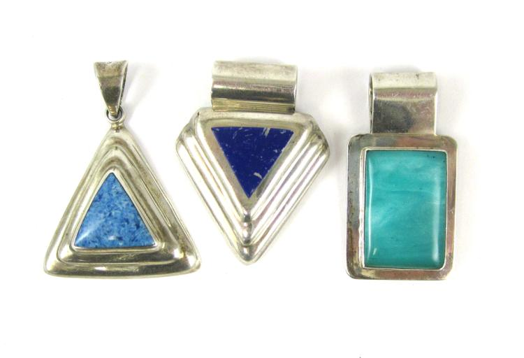 THREE STERLING SILVER PENDANTS, including a sterli