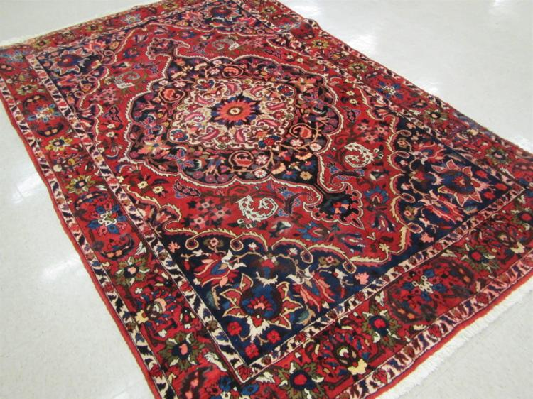 SEMI-ANTIQUE PERSIAN TRIBAL CARPET, hand knotted i