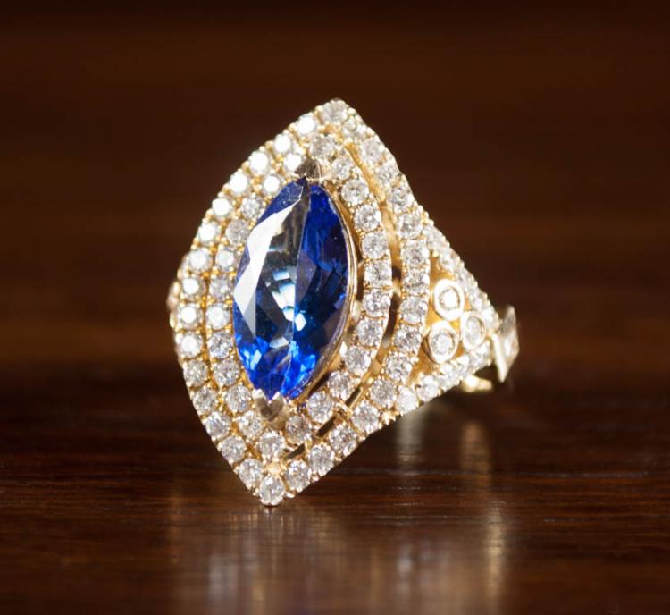 TANZANITE, DIAMOND AND FOURTEEN KARAT GOLD RING, w