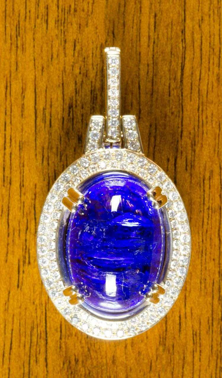 TANZANITE, DIAMOND AND FOURTEEN KARAT GOLD PENDANT