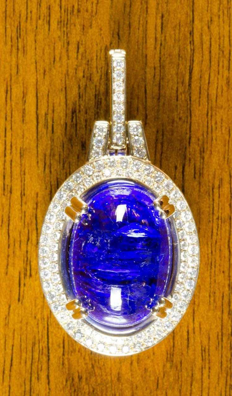 TANZANITE, DIAMOND AND FOURTEEN KARAT GOLD PENDANT