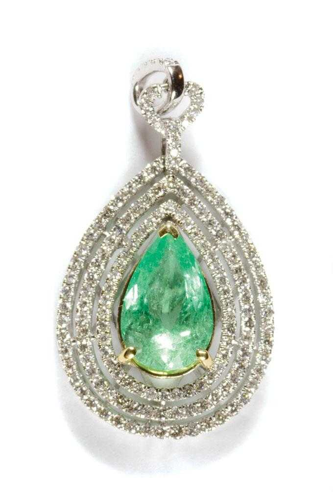 EMERALD, DIAMOND AND EIGHTEEN KARAT GOLD PENDANT.