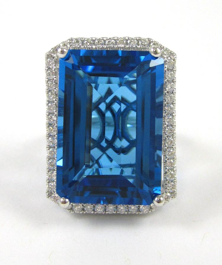 BLUE TOPAZ AND FOURTEEN KARAT WHITE GOLD RING, wit