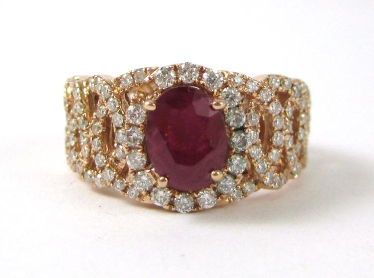 RUBY, DIAMOND AND FOURTEEN KARAT GOLD RING. The r